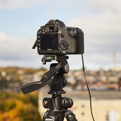A DSLR camera on a tripod