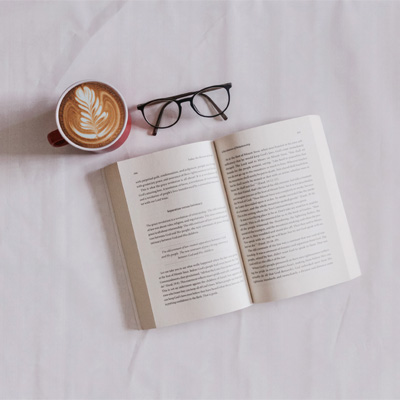 An open book and a pair of glasses