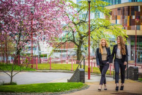 Valeria and Veronika Walking outside Richmond Blossom