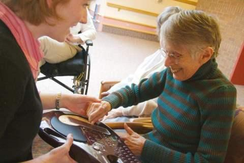 image of dementia patient with carer