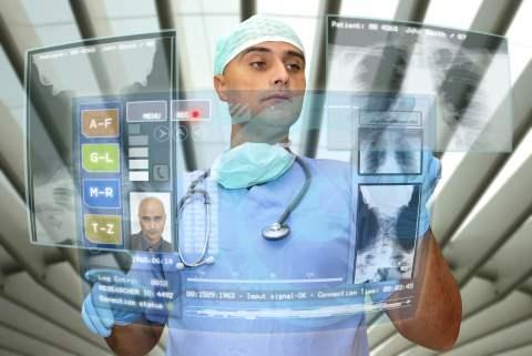 image of doctor working with transparent digital screens