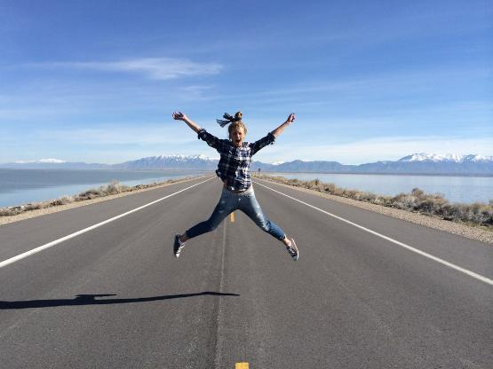 A jumping student on a desert highway
