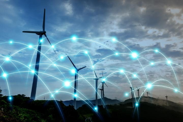 smart grid image above wind turbines at night