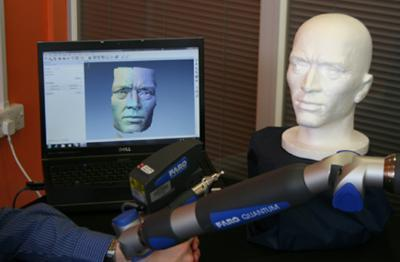 a computer screen showing a laser scan of a model head