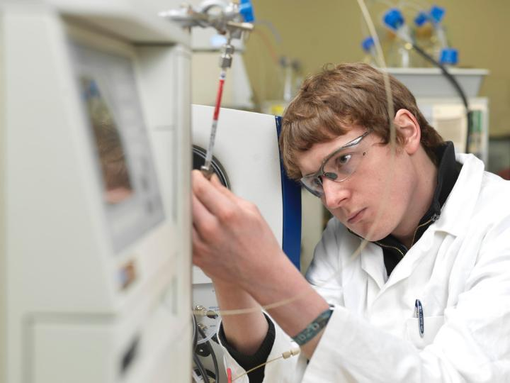 A student using the Mass Spectrometer