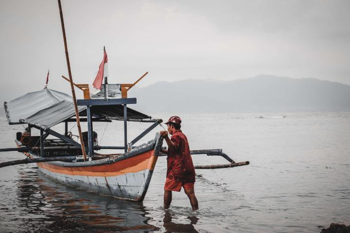 Fishing boat with fisherman in Lampung Indonesia