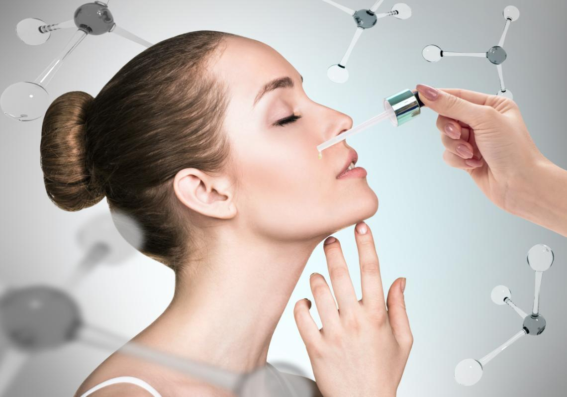 Woman having serum applied to her face