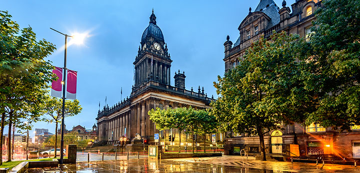 Leeds city centre at night showing the town hall
