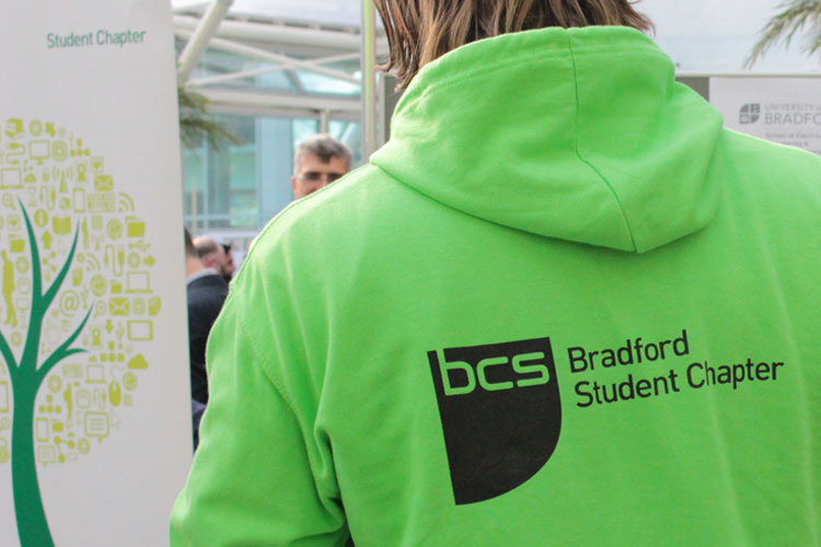 A student wearing a Bradford Student Chapter hooded top.